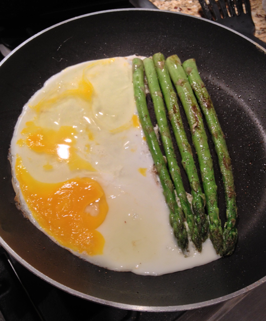 eggs and asparagus cooking
